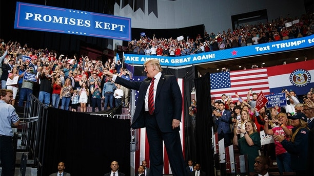 President Donald Trump arrives to speak during a campaign rally, Friday, Sept. 21, 2018, in Springfield, Mo. (AP Photo/Evan Vucci)
