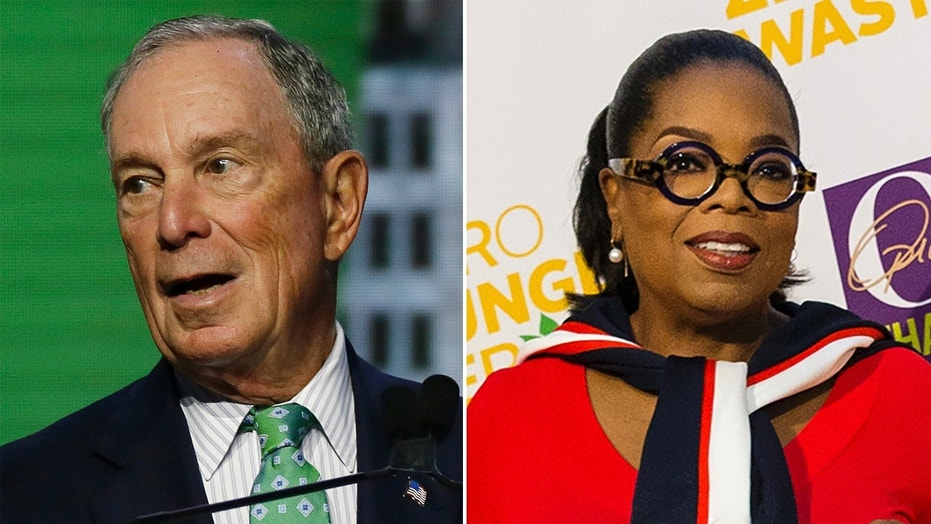 Michael Bloomberg and his choice for commerce secretary, Oprah Winfrey.