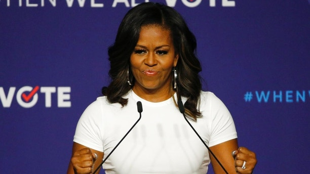 Former first lady Michelle Obama speaks at a rally to encourage voter registration, Sunday, Sept. 23, 2018, in Las Vegas. (AP Photo/John Locher)