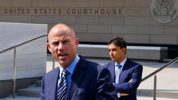 FILE - In this July 27, 2018 file photo Michael Avenatti, the attorney for porn actress Stormy Daniels replies to questions by reporters during a news conference in front of the U.S. Federal Courthouse in Los Angeles. A federal judge will consider Monday, Sept. 24, 2018, whether to toss out a lawsuit brought by Daniels against President Donald Trump and his former lawyer, Michael Cohen, weeks after Trump conceded a non-disclosure deal she signed just before the 2016 presidential election is invalid. (AP Photo/Richard Vogel,File)