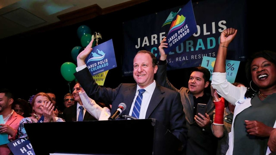U.S. Rep Jared Polis waves to the crowd while accepting the Democratic nomination for the Colorado governor's race at an Election Night rally in Broomfield, Colo., June 26, 2018.