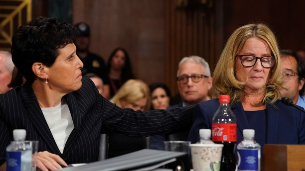 Attorney Debra Katz puts her hand on Christine Blasey Ford as she testifies before the Senate Judiciary Committee on Capitol Hill in Washington, Thursday, Sept. 27, 2018. (AP Photo/Andrew Harnik, Pool)
