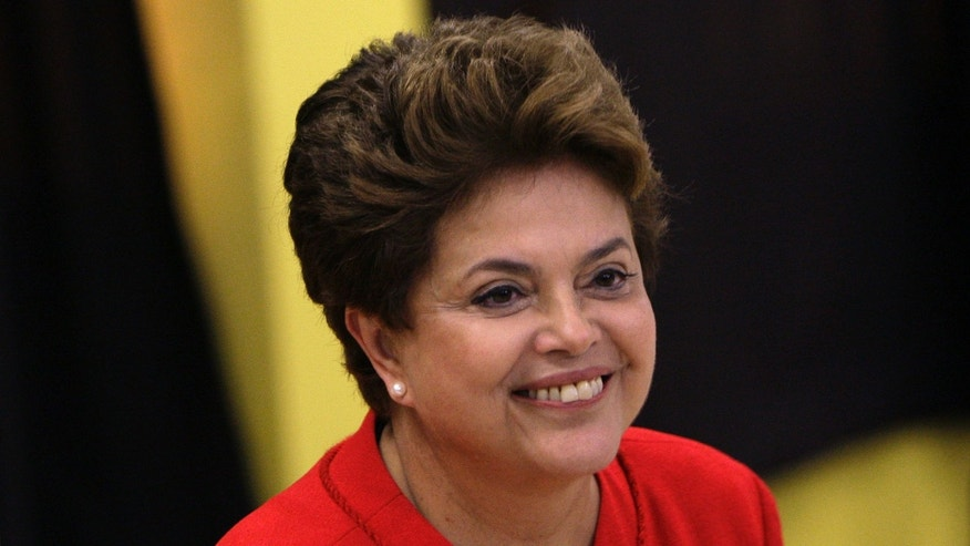Dilma Rousseff, presidential candidate for the Workers Party, smiles after voting during Brazil's general elections at a polling station in Porto Alegre, Brazil, Sunday, Oct. 3, 2010. Brazilians vote Sunday in national elections that could see front-running candidate Dilma Rousseff become the country's first female president, succeeding her popular ally and mentor. (AP Photo/Felipe Dana)