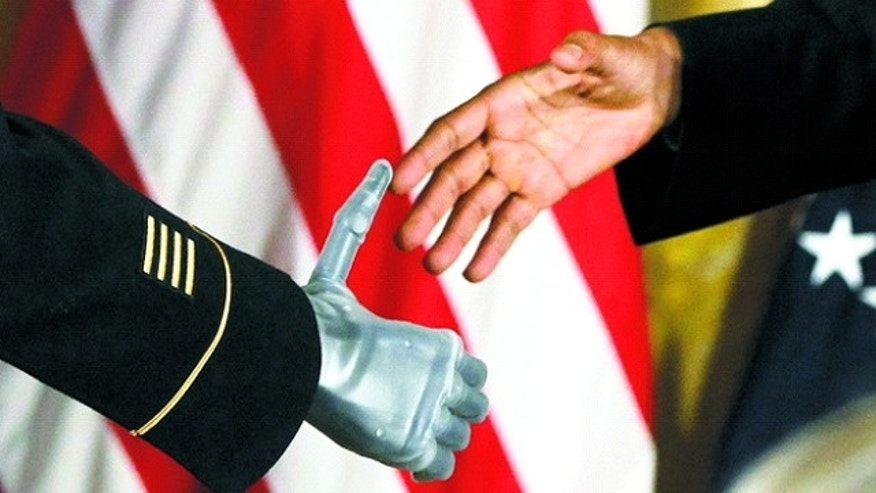 This image shows Sgt. Leroy Petry's bionic arm going in for a handshake with President Obama on July 13.