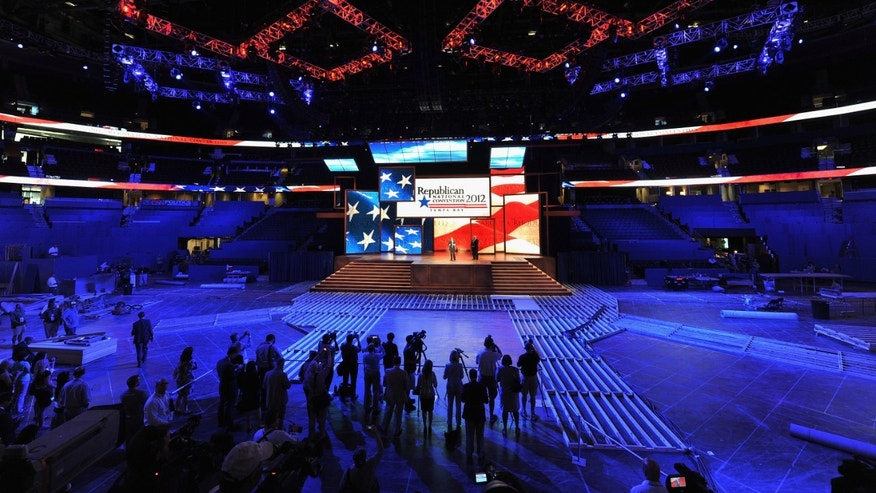 TAMPA, FL - AUGUST 20:  News media report on the unveiling of  the stage inside of the Tampa Bay Times Forum in preparation for the Republican National Convention on August 20, 2012 in Tampa, Florida. Thousands will decend on Tampa for the four day convention which takes place August 27-30.  (Photo by Tim Boyles/Getty Images)