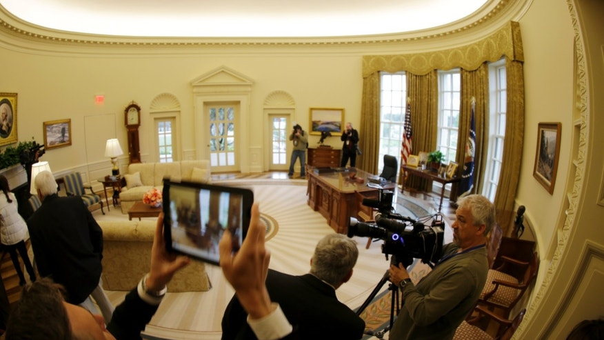 A replica of the Oval Office is seen during a tour of the George W. Bush Presidential Center Wednesday, April 24, 2013, in Dallas.  More than 8,000 people are expected to attend the invitation-only dedication of the center, Thursday, April 25, which will house the presidential library and museum along with the 43rd president's policy institute. It opens to the public on May 1.  (AP Photo/David J. Phillip)