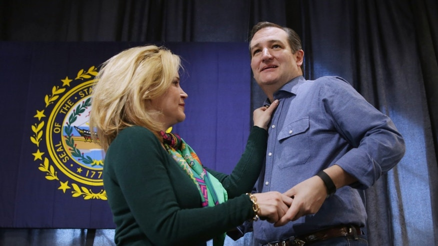 WINDHAM, NH - FEBRUARY 02:  Heidi Cruz adjusts the collar of her husband Republican presidential candidate Sen. Ted Cruz's (R-TX) shirt as he takes the stage during a campaign town hall meeting at the Crossing Life Church February 2, 2016 in Windham, New Hampshire. Cruz emerged at the top of a crowded GOP presidential field after winning Monday's Iowa caucuses.  (Photo by Chip Somodevilla/Getty Images)