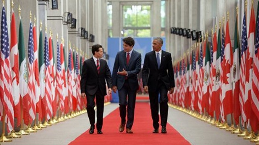 Canadian Prime Minister Justin Trudeau, center, Mexican President Enrique Pena Nieto, left, and U.S. President Barack Obama take part in the North American Leaders Summit at the National Gallery of Canada in Ottawa on Wednesday, June 29, 2016.  (Sean Kilpatrick/The Canadian Press via AP) MANDATORY CREDIT