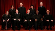 U.S. Chief Justice John Roberts (seated C) leads Justice Ruth Bader Ginsburg (front row, L-R), Justice Anthony Kennedy, Justice Clarence Thomas, Justice Stephen Breyer, Justice Elena Kagan (back row, L-R), Justice Samuel Alito, Justice Sonia Sotomayor, and Associate Justice Neil Gorsuch in taking a new family photo including Gorsuch, their most recent addition, at the Supreme Court building in Washington, D.C., U.S., June 1, 2017. REUTERS/Jonathan Ernst - RTX38JGA