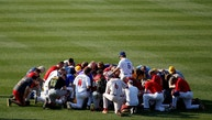 Members of the Republican team pray before the Democrats and Republicans face off in the annual Congressional Baseball Game at Nationals Park in Washington, U.S., June 15, 2017.   REUTERS/Joshua Roberts - RTS179U2