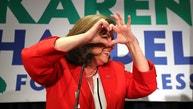 Karen Handel makes a heart symbol while making an early appearance to thank her supporters after the first returns came in during her election night party in the 6th District race with Jon Ossoff on Tuesday, June 20, 2017, in Atlanta. (Curtis Compton/Atlanta Journal-Constitution via AP)