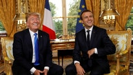 French President Emmanuel Macron and U.S. President Donald Trump (L) react as they meet at the Elysee Palace in Paris, France, July 13, 2017.   REUTERS/Kevin Lamarque - RTX3BBSL