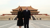 President Donald Trump, right,  and first lady Melania Trump, left,  pose for a photo as they tour the Forbidden City, Wednesday, Nov. 8, 2017, in Beijing, China. Trump is on a five country trip through Asia traveling to Japan, South Korea, China, Vietnam and the Philippines. (AP Photo/Andrew Harnik)