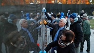 Vice President Mike Pence, with his wife Karen Pence, foreground and Interior Secretary Ryan Zinke clean a portion of the wall at the Vietnam Veterans Memorial on Veterans Day, Saturday, Nov. 11, 2017 in Washington. (AP Photo/Alex Brandon)
