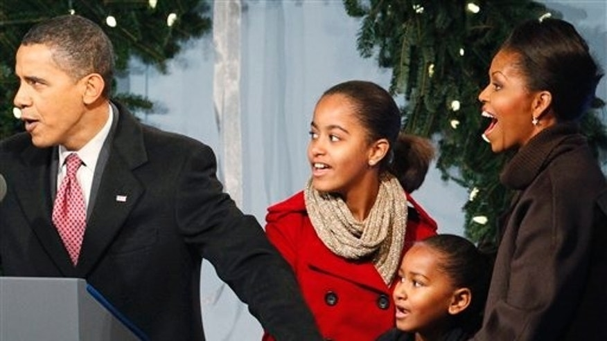 President Barack Obama, first lady Michelle Obama and daughters Sasha and Malia help to light the National Christmas Tree, Thursday, Dec. 3, 2009, in Washington. (AP Photo/Haraz N. Ghanbari)