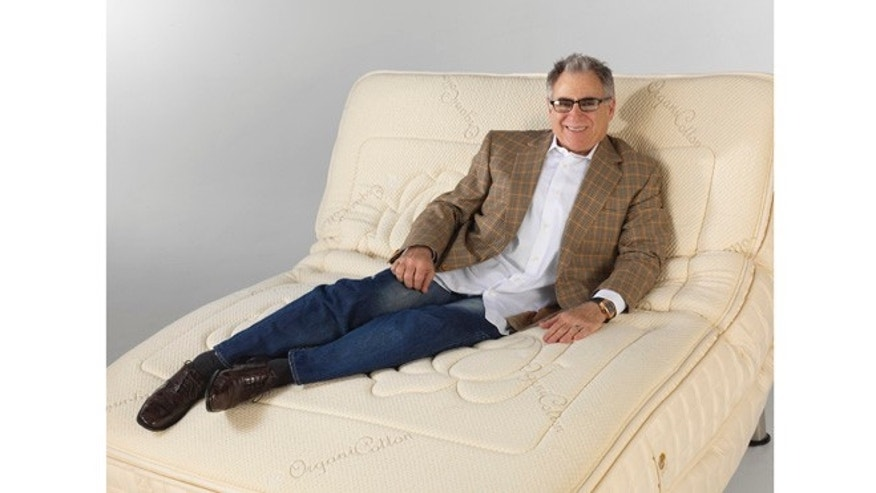 This undated image show Earl Kluft, the owner of the luxury mattress brand E.S. Kluft & Co., relaxing on one of his hand-tailored models.