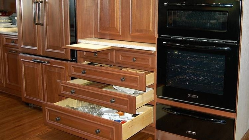 The Owens' kitchen storage is designed to minimize lifting.