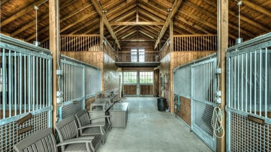 This fully equipped horse barn will keep your steeds comfy.