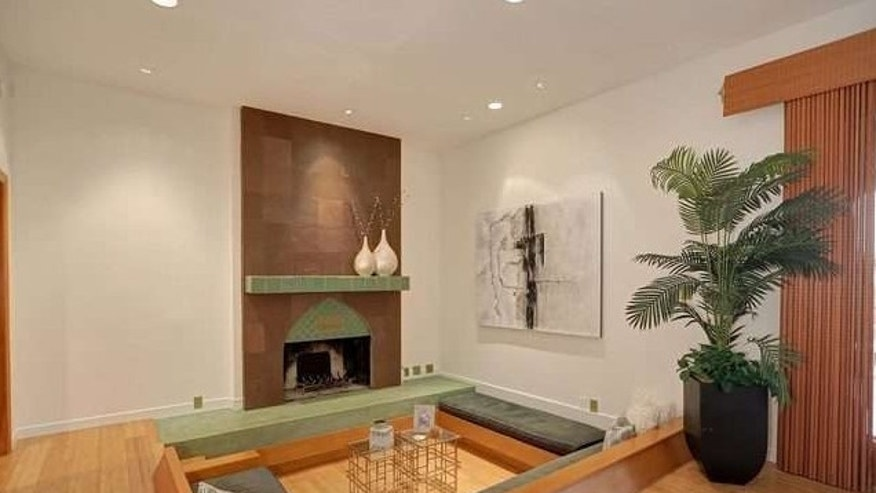 Conversation pit, with fireplace.