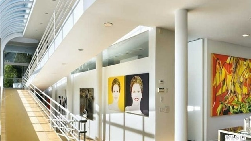 The atrium-like wall of glass shines light on art and the winding ramp.