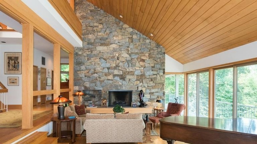 The living room's massive stone fireplace.