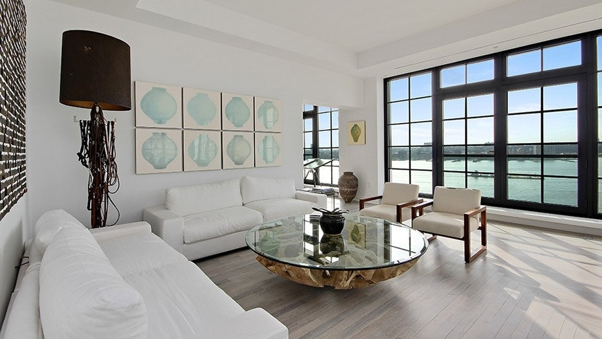 Floor-to-ceiling windows throughout the home offer views of the Hudson River.