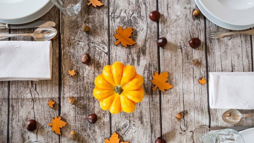 Autumnal laid table with yellow pumpkin