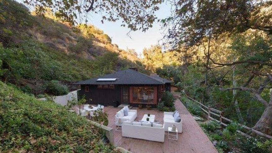 The property is tucked away between canyon and trees.