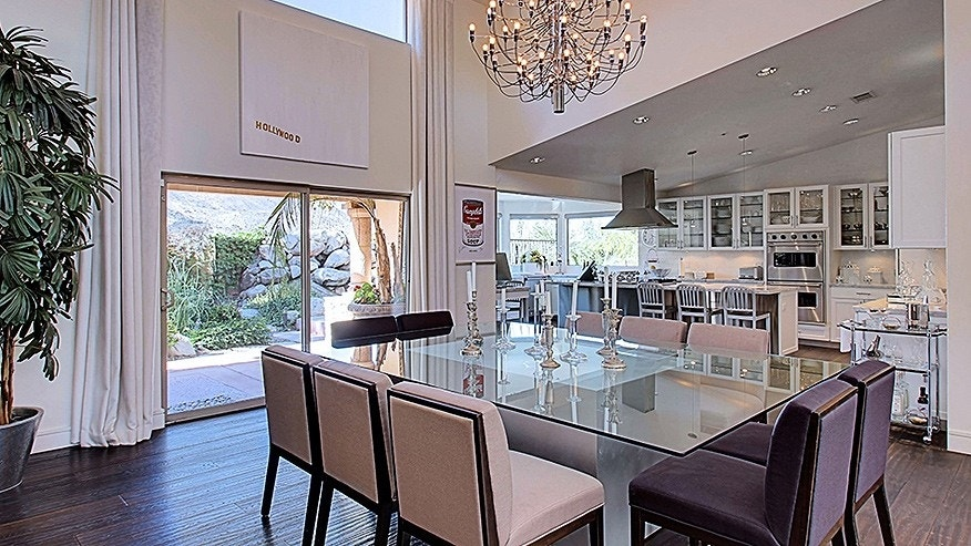 Sliding glass doors that lead to patio areas flank the dining room.