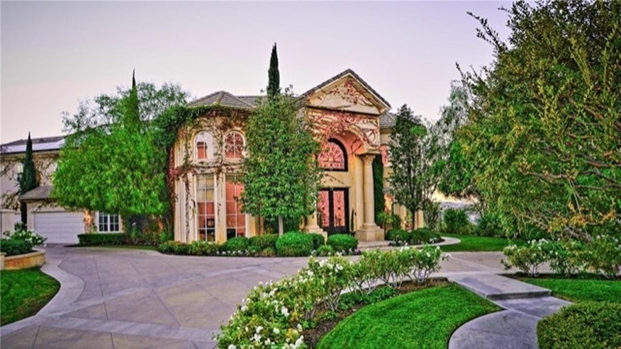 Outside the French-style home.
