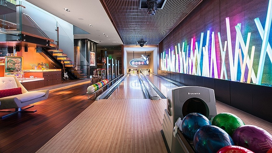 The lower level was designed for entertaining. It features a two-lane bowling alley with an automated ball return.