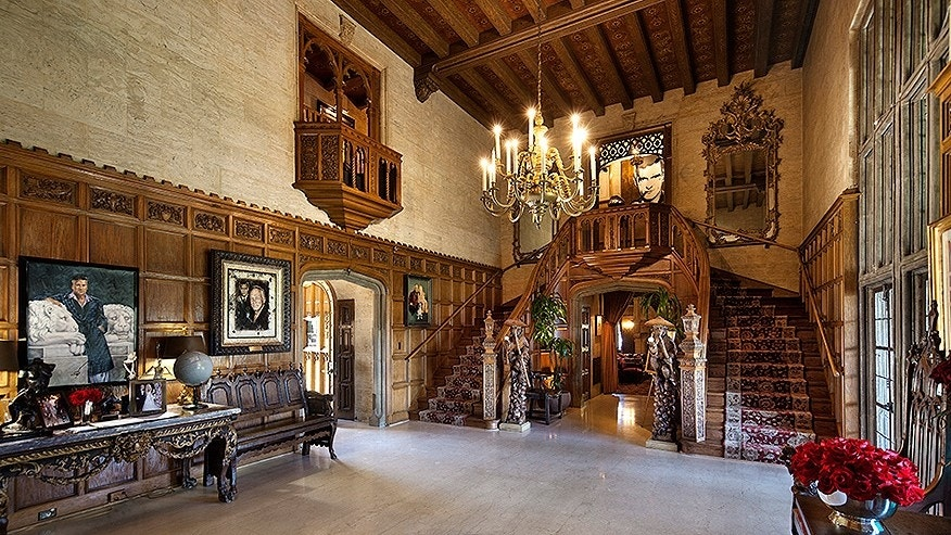 A hall on the first floor of the mansion features 22-foot high ceilings. There are six bedrooms on the second floor.