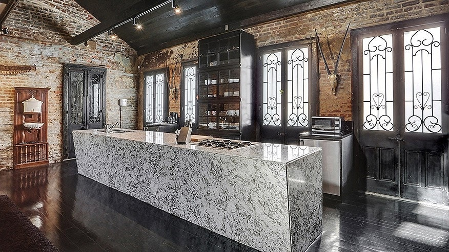 There's a 14-foot long granite island in the open kitchen.