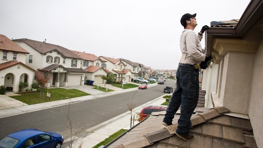 SACRAMENTO, CA - DECEMBER 2: NorthWoods inspector Manny Nevarez inspects the roof of a foreclosed home for needed repairs December 2, 2008 in Sacramento, California. Many foreclosed homes need substantial repairs before going on the market. (Photo by Max Whittaker/Getty Images)