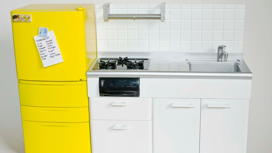 A boldly spray-painted refrigerator gives this kitchen new life!