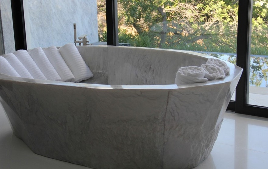This elegant resin tub is more affordable-- and much more lightweight-- than traditional stone.