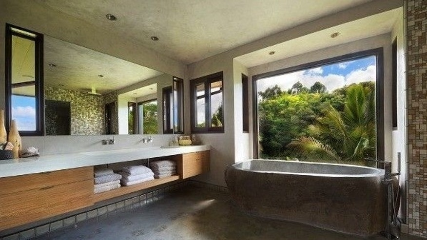 Master bathroom with river rock tub.