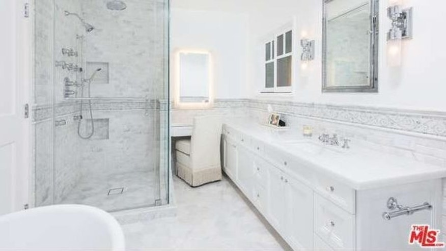 Luxurious, white bathrooms.