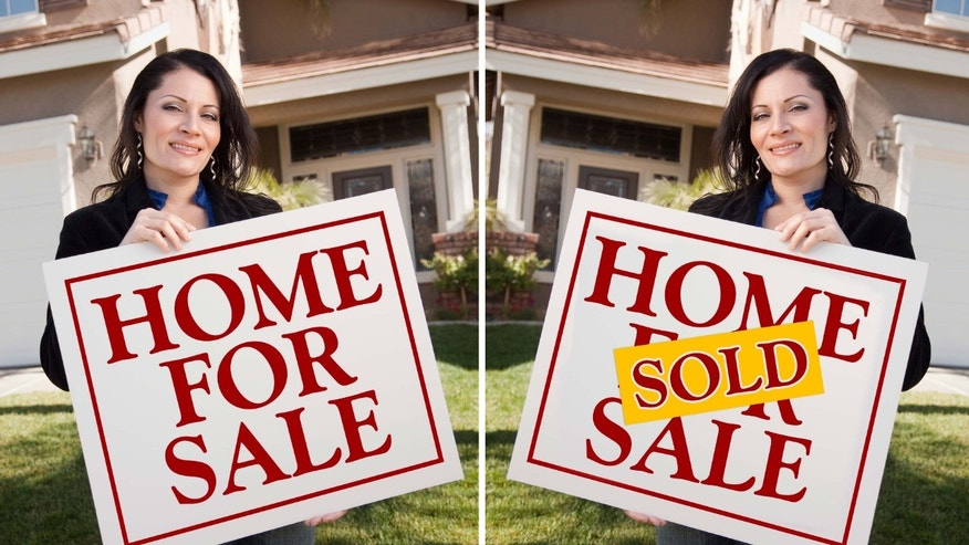Realtor holding sign