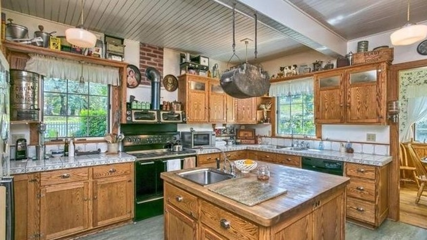 The home's owner, George Rambo, custom built the woodwork in the main kitchen and throughout the home.