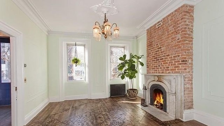 One of three wood-burning fireplaces in the Brooklyn townhouse actress Lake Bell recently put on the market