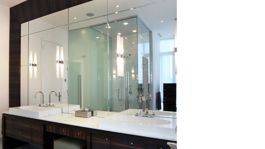 Well-placed mirrors can make your bathroom look bigger.