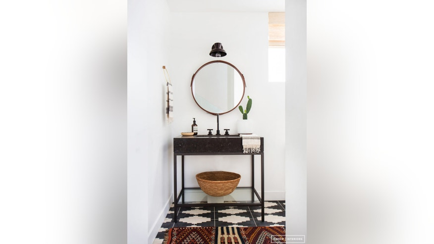 Sleek stone atop a glass frame equals a modern vanity