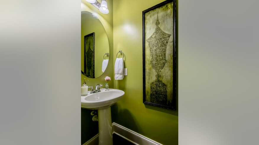 Eye-popping chartreuse works well in this tiny bath