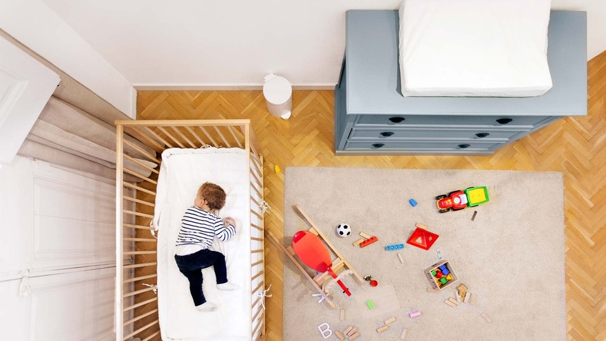 toddler sleeping in small nursery