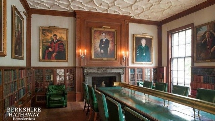Paintings of various leaders of the International College of Surgeons frame the walls.