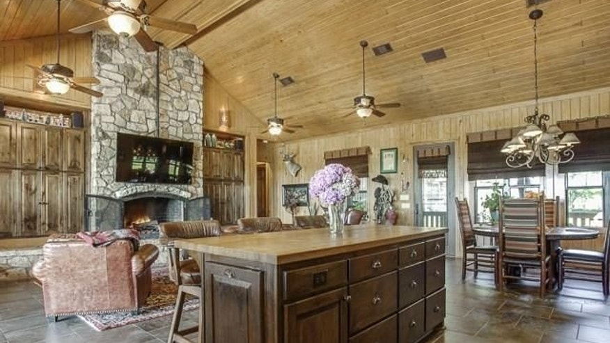 Massive fireplaces and wood-beamed ceilings give the ranch its rustic charm.