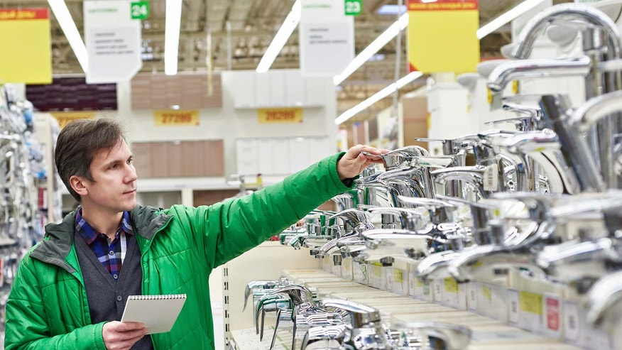 shopping in hardware store for faucets