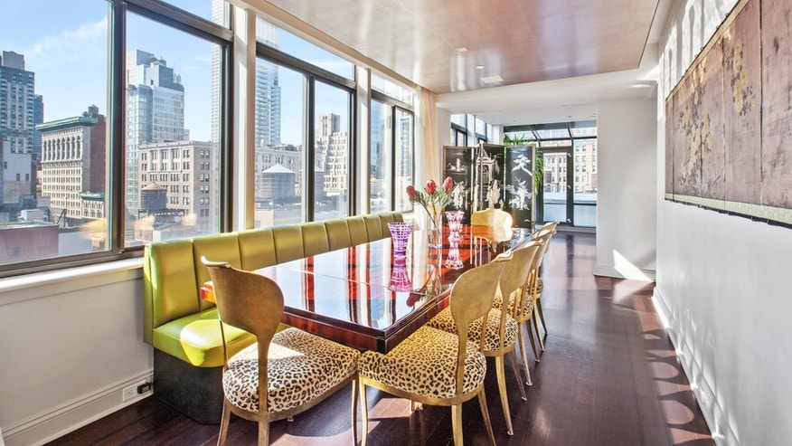 A dining area overlooking the city skyline.