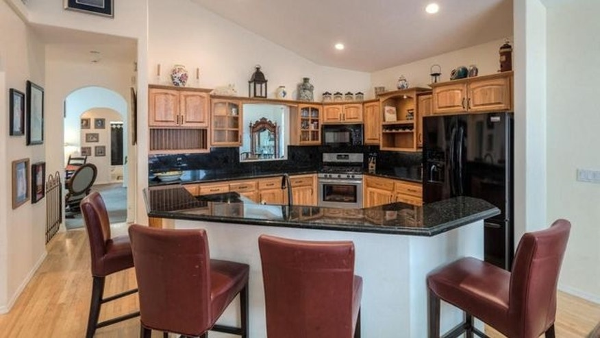 The home features granite counters throughout.